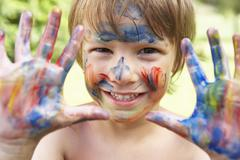 Head And Shoulders Portrait Of Boy With Painted Face and Hands - stock photo