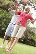 Energetic Senior Couple In Countryside Stock Photos