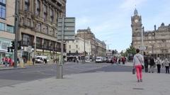 Tourists walking in Princess Street in Edinburgh, Scotland Stock Footage