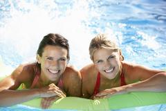 Two Women On Holiday In Swimming Pool Stock Photos
