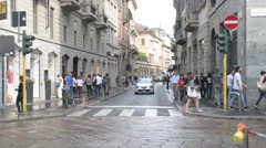 Milan city center. Vehicles and pedestrians on the street Monte Napoleone Stock Footage