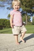 Little Girl Walking In Park Stock Photos