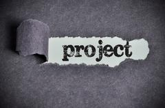 project word under torn black sugar paper - stock photo