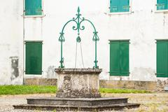Stock Photo of The old water well,Italy