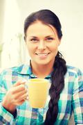 lovely housewife with mug - stock photo