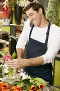 Male Florist In Shop Taking Order Over Telephone Stock Photos