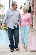 Senior Couple Carrying Shopping Bags Stock Photos