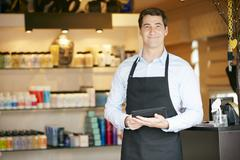 Portrait Of Male Sales Assistant In Beauty Product Shop - stock photo