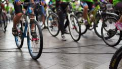 abstract biking tournament at start line, shot of a group of race cyclists - stock footage