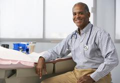 Portrait Of Male Doctor In Surgery Stock Photos