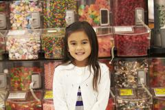 Girl At Candy Counter In Supermarket - stock photo
