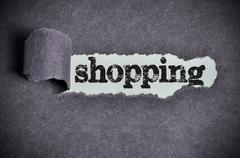 Shopping word under torn black sugar paper Stock Photos