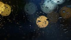 Abstract blur traffic lighting in the rain with bokeh Stock Footage