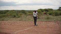 Measuring road survey, Kenya, long shot Stock Footage