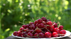 Mouthwatering Cherries In A White Plate Stock Footage
