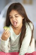 Unhappy Young Girl Rejecting Plate Of Fresh Vegetables - stock photo