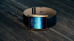 Close-up Of Smartwatch On Wooden Desk Stock Footage