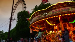ULTRA HD 4K real time shot,Amusement park carousel near London Eye Stock Footage