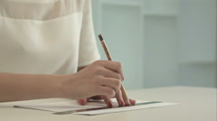 Woman architect drawing line on a ruler Stock Footage