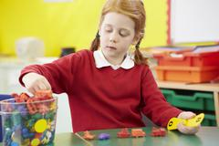 Female Pupil Practising Maths At Desk - stock photo