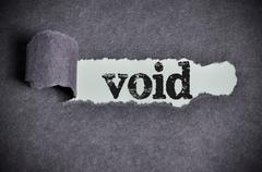 void word under torn black sugar paper - stock photo