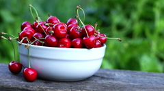 Mouthwatering Cherries In A White Bowl. A Woman's Hand Take One Cherry Stock Footage