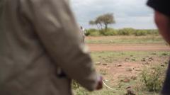 Measuring distance to road, Kenya, medium shot, shallow DOF Stock Footage