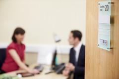 Consultant Meeting With Patient In Office - stock photo
