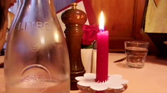 Red Candle at dinning table looking at menu Stock Footage
