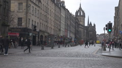 Scottish cityscape in capital Edinburgh, people and cars walk, move downtown Stock Footage