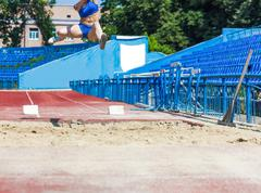 athletics competitions in long jump - stock photo