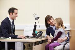 Appointment For Mother And Daughter With Doctor - stock photo