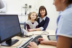 Appointment For Mother And Daughter With Nurse - stock photo