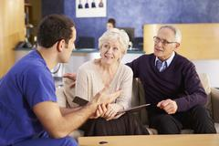 Senior Couple Meeting With Nurse In Hospital Stock Photos