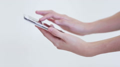 Hand with smart phone on white isolate background Stock Footage