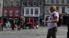 Visitors walking along Royal Mile in Edinburgh, June 2015 Stock Footage