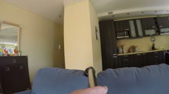 Man hands hoovering dust from sofa with vacuum cleaner. 4K Stock Footage