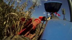 Tractor harvesting corn Stock Footage