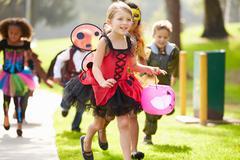 Children In Fancy Costume Dress Going Trick Or Treating Kuvituskuvat