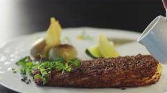 Chef is Garnishing Fish Steak Dish in Luxury Restaurant Stock Footage
