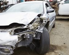 Damaged Car Involved In Traffic Accident - stock photo