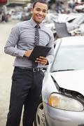 Loss Adjuster Using Digital Tablet In Car Wreck Inspection - stock photo
