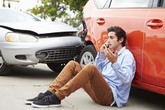 Teenage Driver Making Phone Call After Traffic Accident - stock photo