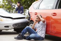 Male Driver Making Phone Call After Traffic Accident - stock photo
