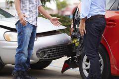 Two Drivers Arguing After Traffic Accident - stock photo