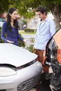 Two Drivers Inspecting Damage After Traffic Accident - stock photo