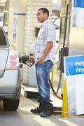 Male Driver Filling Car At Gas Station Stock Photos