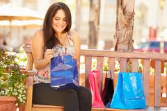 Woman Resting With Shopping Bags Sitting In Mall Stock Photos