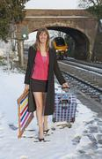 Holidaymaker departing the cold English weather by train - stock photo