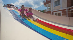 Child on water slide at aquapark. Summer holiday - stock footage